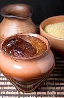 Millet porridge in a clay pot.