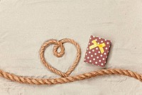 Gift box and rope in heart shape