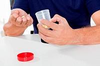 Senior Man Holding Pills And Bottle