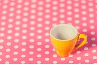 Cup of a coffe on polka dot cover