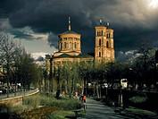 Germany, Berlin, Kreuzberg, Protestant church St Thomas Church, dark clouds