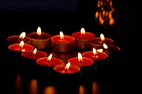 Candles forming heart