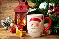 Santa's Cup with Christmas Decoration Background