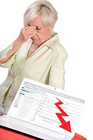 Elderly looking depress having to face her business bankruptcy.