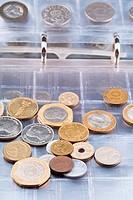 numismatics album with different coins
