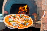 hot seafood pizza from old pizza oven