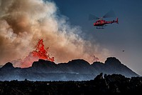 Helicopter flying over the volcano eruption at the Holuhruan Fissure, Bardarbunga Volcano, Iceland. August 29, 2014 a fissure eruption started in Holu...
