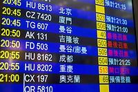 Airline departures boards at Hong Kong International Airport, Chek Lap Kok, New Territories, Hong Kong, China.