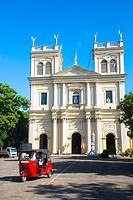 Sint Mary Church with red tuktuk in Negombo, Sri Lanka