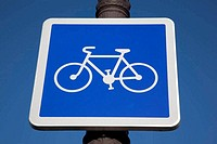 Blue Bike Sign on Sky Background