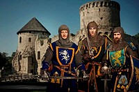 Three knights against medieval castle.