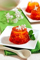 Gelatin with red berries and jasmine flowers.