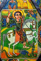 Old painting depicting a Saint on a horse fighting a dragon - visual from a bible scene, Addis Ababa, Ethiopia, Africa.