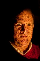 Portrait of man illuminated by fiber optic light source, where dark spots indicate broken fibers in the bundle, MR# 150201. .