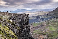 Photographers in top cliff of Haifoss waterfall, South Iceland.