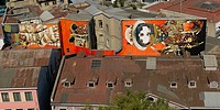 Elevated view of buildings with painted mural, Valparaiso, Chile