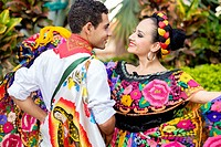 Colorful Mexican costumes - Puerto Vallarta, Jalisco, Mexico. Xiutla Dancers - a folkloristic Mexican dance group in traditional costumes representing...