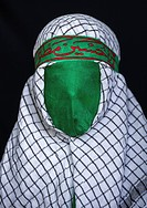 Iranian Young Man With Green Veil Covering His Face During Chehel Menbari Festival On Tasua To Commemorate The Martyrdom Of Hussein, Lorestan Province...