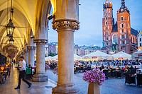 St Mary´s Basilica, from arcade of Cloth Hall, at Main Market Square Rynek Glowny, Krakow, Poland.