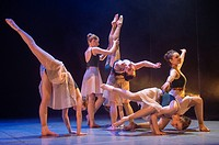 A group of young teenage girl student ballet dancers at Aberystwyth Arts Centre Dance School dancing on stage in an adaptation of JM Barrie´s Peter Pa...