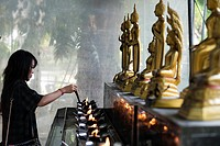 Woman praying in Wat Patum Wanaram Tample. Bangkok. Wat Pathum Wanaram is a Buddhist temple in Bangkok, Thailand. It is located in the district Pathum...