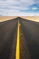 A deserted two-lane highway north of Marfa. State Highway 17, Presidio County, Texas, USA.