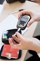 Diabetic woman measuring sugar
