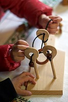Wooden puzzle games. Traditional costumes and folk traditions at Easter Festival in Hollók?, UNESCO World Heritage-listed village in the Cserhát Hills...