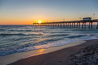 Sunset over Gulf of Mexico at Venice Pier in Venice Florida.