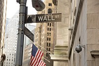 The iconic street in New York has become the symbol for money, power and finance. The new signage was part of a recent move to update city streets. Wa...