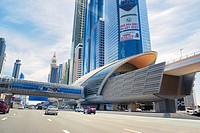 City of Dubai. Financial Centre Metro Station on Sheikh Zayed Road. Al Yaquob Tower in distance. United Arab Emirates.