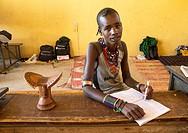 Ethiopia, Omo Valley, Turmi, hamer tribe boy in classroom.