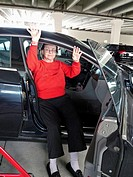 Mature woman leaving hospital 4-days after knee replacement surgery.
