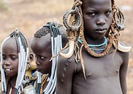 Ethiopia, Omo Valley, Mago park, mursi tribe children with adornments on the heads.