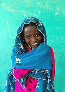 Ethiopia, Afar Region, Semera, portrait of a smiling afar tribe girl.