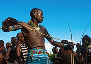 Ethiopia, Omo Valley, Turmi, hamer tribe maze whipping a woman during a bull jumping ceremony.
