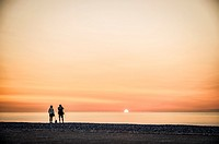 Tourists enjoying the sunset in Veulettes-sur-Mer (department of Seine-Maritime, region of Normandie, France).
