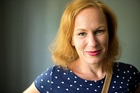 Tilburg, Netherlands. Studio-portrait of a red-haired woman.