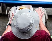 Overhead view of a a hat on a man´s head at an outdoor event.
