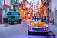 A classic American car at night in Centro Habana at dusk. Havana, Cuba.