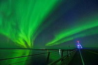 Aurora borealis (northern lights) in the night sky over the MacKenzie River with the Deh Cho Bridge, Fort Providence, Northwest Territories, Canada.