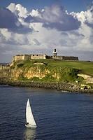 Sailboat below fortress El Morro, San Juan, Puerto Rico.