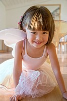 Toddler girl wearing her fairy costume.