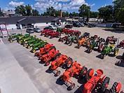 Historic antique farm tractors on display.