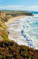 Half Moon Bay California shore ocean cliffs off of the Ritz Golf Course with waves sand at Half Moon Bay Golf Links.