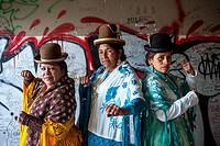 At left Angela la Folclorista , in the middle Dina, and at right Benita la Intocable, cholitas females wrestlers, El Alto, La Paz, Bolivia.