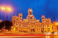 Spain, Madrid, Plaza de Cibeles, Twilight view of the Cybele Palace.