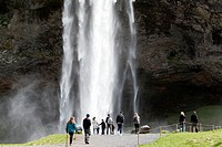 tourists in front of Seljalandsfoss waterfall iceland.