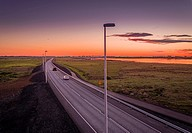 Sunset over road to Alftanes, a suburb of Reykjavik, Iceland. This image is shot using a drone.