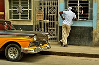 residents doing their business along Calle Neptuno in Central Havana, La Habana (Havana), Habana, Cuba.